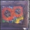 "TANGERINE SUNFLOWERS -- Artist: Deb Chaussee Size: 21"" x 18"" Medium: Glass Price: $285.00 ***SOLD***"