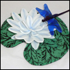 "WATER LILY WITH DRAGONFLY -- Artist: Barb Byrne Size: 9"" x 4"" Medium: Glass Price: $300.00"