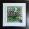 "CLEMATIS VINE WITH 3D HUMMINGBIRD -- Artist: Barb Byrne Size: 8"" x 8"" Medium: Glass Price: $295.00"